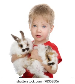 Happy boy is holding a two rabbits. isolated on white background