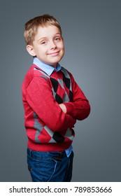 happy boy isolated against grey background