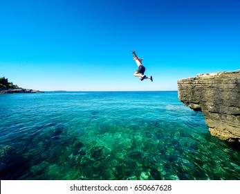happy boy jumping in the croatian sea