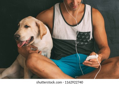 happy boy with labrador retriever dog puppy happy with his seated mobile phone listening to music comunicaciones