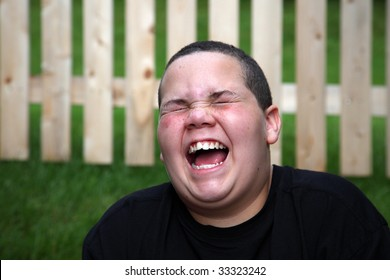 Happy boy laughing with open mouth