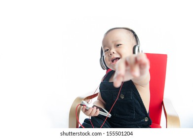 happy boy listening to music on headphones against white
