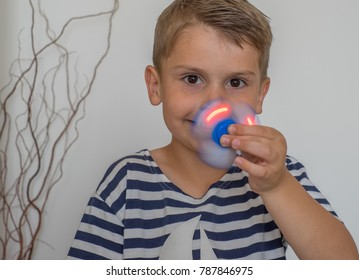 Happy boy with luminous spinner