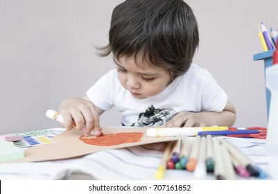 Happy boy making Easter greeting card in egg shape,Materials for art creativity on kid table, children painting for easter egg, Paper crafts activity in kindergarten with parents or learning at home