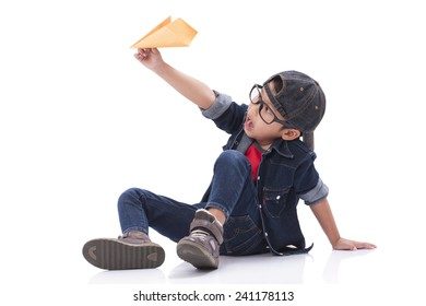 Happy boy playing with paper airplane