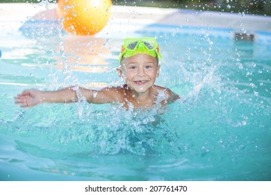 Happy boy playing in swimming pool
