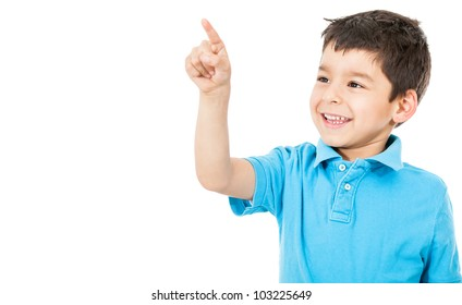 Happy boy pointing with his finger - isolated over a white background