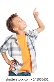 Happy boy pointing up isolated on white background
