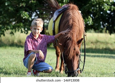 happy boy and pony horse