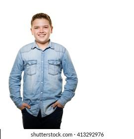 Happy boy posing at camera on white background.
