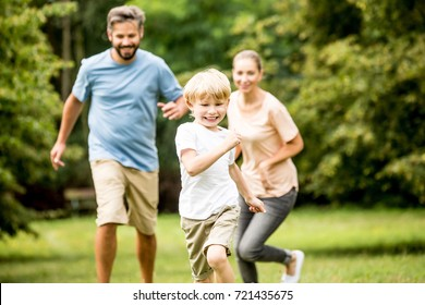 Happy boy racing his family and having fun in the summer