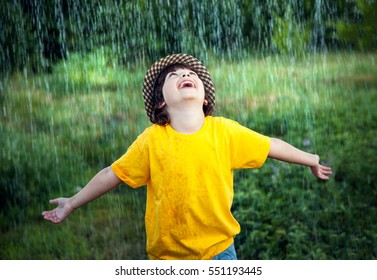 happy boy in rain summer outdoors