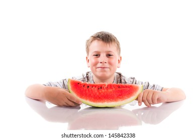 happy boy with ripe watermelon on a white background