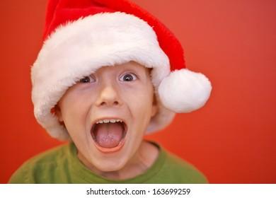 Happy boy with Santa Claus hat