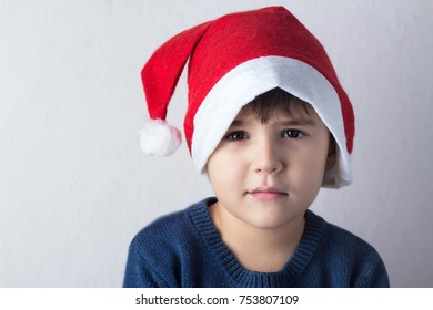 "happy boy in santa claus hat, concept of ""new year and christmas"""