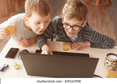 Happy boy sitting With laptop computer