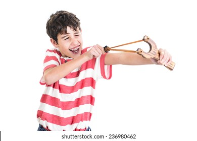 Happy boy with a slingshot