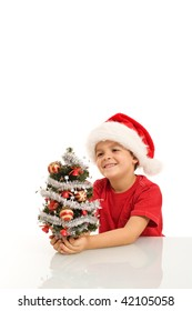 Happy boy with small christmas tree and santa hat - isolated