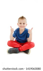 Happy boy smiling and liking by pointing thumb fingers up, white sitting with cross legs. Isolated on white background