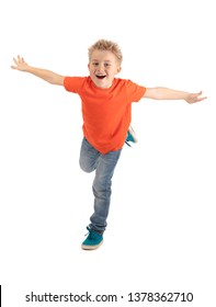 HAPPY BOY SMILING WHILE STANDING ON ONE LEG AND MAKING LIKE FLYING ISOLATED ON WHITE BACKGROUND