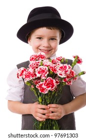 Happy boy standing with a bouquet of pink carnations, isolated on white