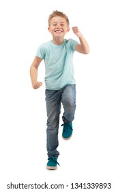 HAPPY BOY STANDING ON ONE LEG AND SKIPPING ISOLATED ON WHITE BACKGROUND
