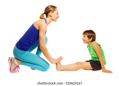 Happy boy stretching sitting on the floor with mom