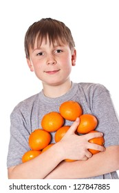 happy boy with tangerines on a white background