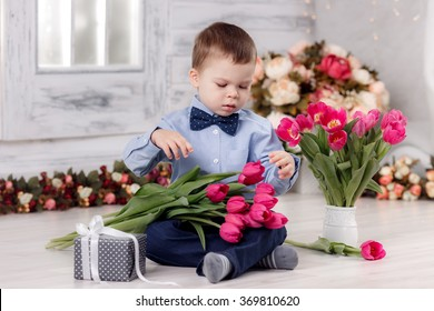 Happy boy with tulips. March 8, International Women's Day, Mother's Day