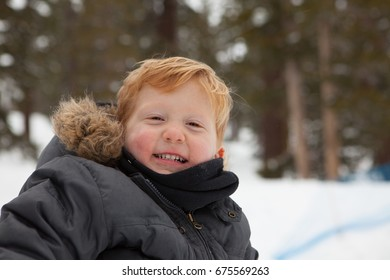 Happy boy in the winter time