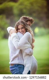 happy boyfriend and girlfriend hugging and in love