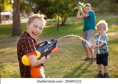 happy boys playing with water guns