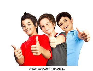 Happy boys, teenagers smiling, thumbs up, portrait of best friends isolated on white background, cute kids having fun