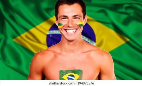 Happy brazilian fan celebrating over brazil flag background