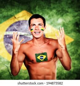 Happy brazilian fan over brazil flag background