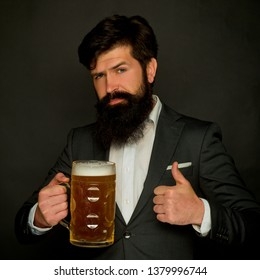 Happy brewer. Bearded man with a glass of beer. Beer in the UK. Happy smiling man with beer. Happy brewer holding glass with beer. Barman. Happy brewer