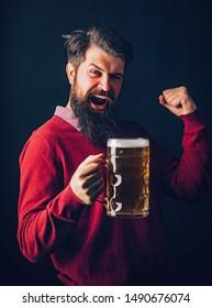 Happy brewer holding glass with beer. Beer in Belgium. Brewer. Beer in Germany. Beer in the US