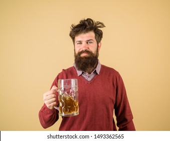 Happy brewer. Happy male brewer holds glass with beer. Tasting fresh brewed beer. Brewer holds glass with craft beer. Brewery concept. Oktoberfest festival. Alcohol. Man with beer of mug. Barman.