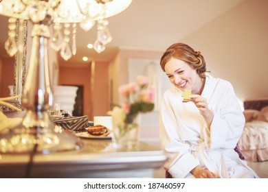 Happy bridal morning. Bride getting ready in hotel room.