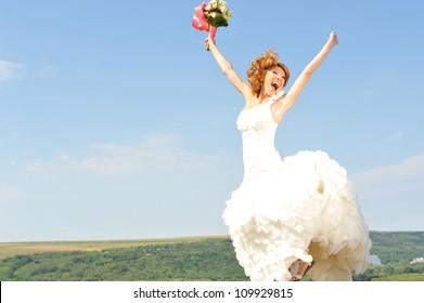 happy bride in a beautiful natural landscape