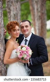 Happy bride and bridegroom are hugging