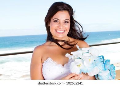 happy bride closeup portrait with bouquet