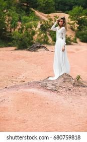 Happy bride enjoy life outdoors. Beautiful woman in wedding dress.