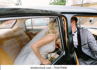 Happy bride and groom in the car