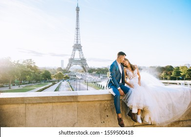 Happy bride and groom enjoying their wedding in Paris