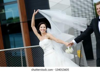 Happy bride and groom in a European city