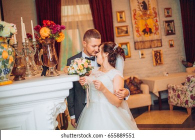 Happy bride and groom in interior of hotel in wedding day