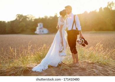 Happy bride and groom on a beautiful beach on sunset