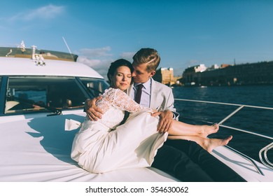 Happy bride and groom on a yacht traveling together on a warm summer day