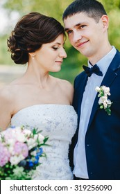 happy bride and groom at a park on their wedding day